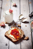 Piece of bread with butter, jam and  yogurt Stock Photo