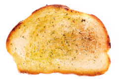 Piece of bread dipped in olive oil Stock Image