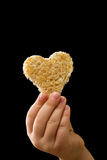 A piece of bread given with love Royalty Free Stock Photography