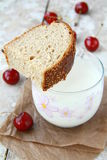 Piece of bread and a glass of milk Royalty Free Stock Photos