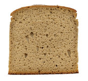 Piece of bread isolated on white. Close-up Stock Images