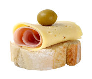 Piece of bread with jam, cheese and olive Royalty Free Stock Photos