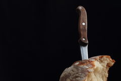 Piece of bread with the knife Stock Images