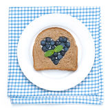 A piece of bread with the middle filled with blueberries Royalty Free Stock Images