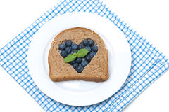 A piece of bread with the middle filled with blueberries Stock Images