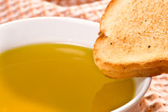 Piece of bread and olive oil Stock Photos