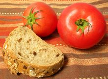 Piece of bread with tomatoes Stock Photography