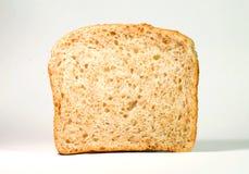 Piece of bread on white Stock Photo