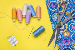 Piece of bright cloth and objects for needlework. stock photo