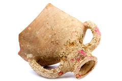 Piece of broken ancient mug with fossils. On white background royalty free stock image