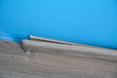 Piece of broken baseboard with the blind stopper Royalty Free Stock Photography