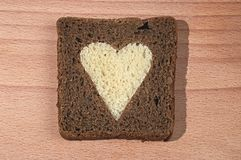 Piece of brown bread with heart Stock Photos