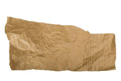 Piece of brown paper, torn on white. Background royalty free stock photo