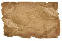 Piece of brown paper, torn on white Stock Images