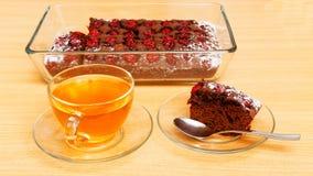 Piece of brownie - chokolate cake with cherry Stock Images