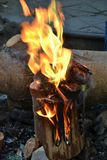 A piece of burning wood royalty free stock photos