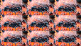 Piece of burnt wood smokes and burns in the fire close-up. Pece of burnt wood smokes and burns in the fire close-up. Multicam split screen group montage stock video