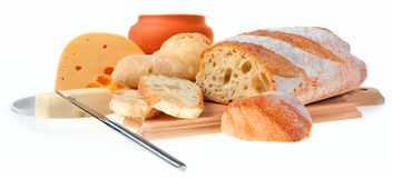Piece of butter, bread and a knife Stock Images