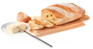 Piece of butter, bread and a knife Stock Photos