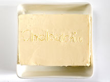A piece of butter with fonts. A piece of butter with writing Royalty Free Stock Images