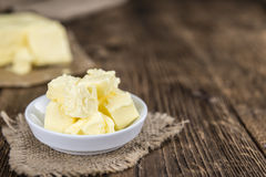 Piece of Butter on wooden background (selective focus) Stock Photos