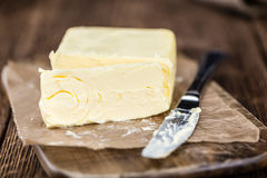 Piece of Butter on wooden background (selective focus) Royalty Free Stock Images