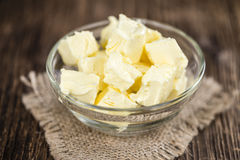 Piece of Butter on wooden background (selective focus) Royalty Free Stock Photo