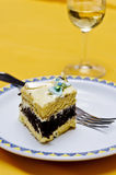 Piece of cake. That looks delicious with great colors with glass of wine Stock Image