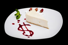 Piece of cake. On a plate with nuts Royalty Free Stock Images