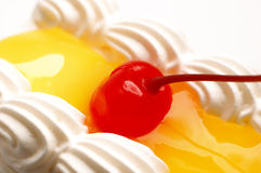 Piece of cake. Piece of lemon jelly cake with cherry on top,on white background Stock Photos