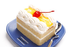Piece of cake. Piece of lemon jelly cake with cherry on top ,on white background Stock Images