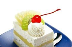 Piece of cake. Piece of fresh fruit cake on white background Stock Image