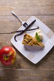 A piece of cake. Apple pie with vanilla ice, mint and apple Stock Photos