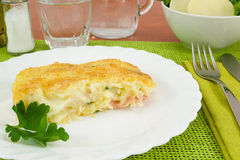 Piece of cake baked potatoes with ham and cheese Stock Photos