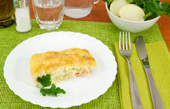 Piece of cake baked potatoes with ham and cheese Stock Image
