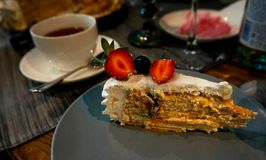 Piece of cake with berries on the holiday table. stock image