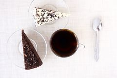 Piece cake. Black tea. Transparent tableware. White background. Delicious dessert Royalty Free Stock Photography