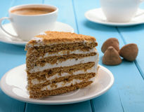Piece of cake on blue wooden table Royalty Free Stock Photo