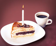 Piece of cake with a candle Royalty Free Stock Photos