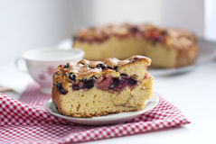 Piece of cake with cherries. Photo sponge cake with cherries on a plate Royalty Free Stock Image
