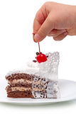 Piece of cake with a cherry and baby Stock Photography