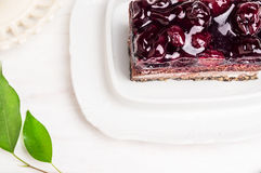 Piece of cake with cherry and jelly Royalty Free Stock Photos