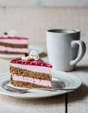 Piece of cake with a chocolate biscuit, berry mousse and jelly Royalty Free Stock Photos