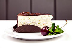 Piece of cake with chocolate, cherry and mint Royalty Free Stock Photo