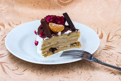 Piece of cake with chocolate and fruits Stock Images