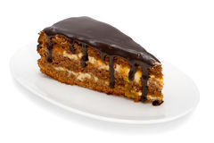 Piece of cake with chocolate glaze Stock Images