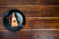 Piece of cake with cinnamon and anise on the side Royalty Free Stock Photography