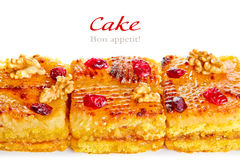 Piece of cake, cinnamon sticks and dried berries Stock Photography