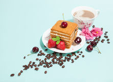Piece of cake and coffee cup with decoration Stock Image