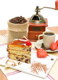 A piece of cake and coffee on white background Stock Images